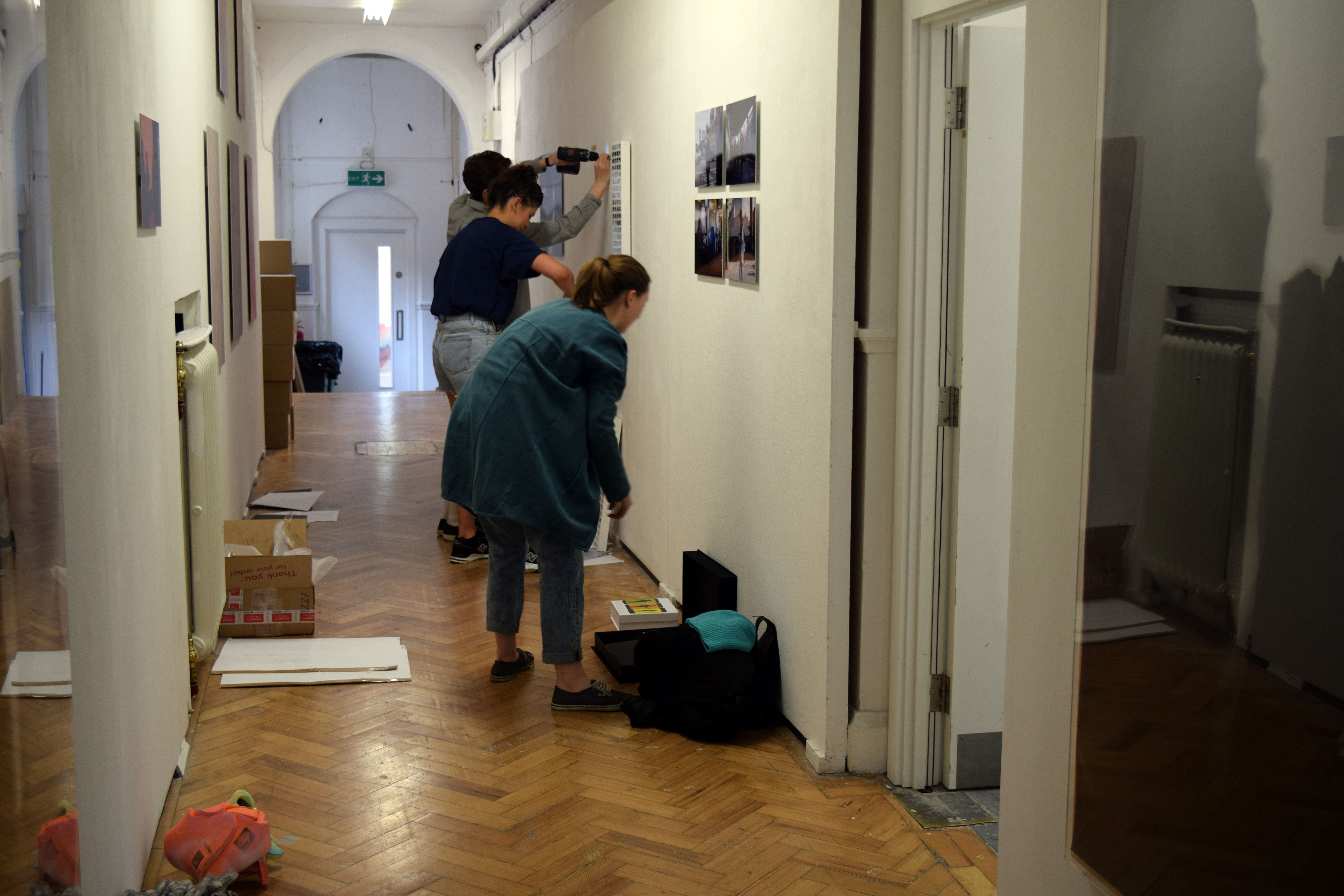 BA Photography students hanging in the corridor