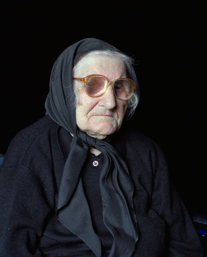 Photograph of an elderly lady in mourning clothes.