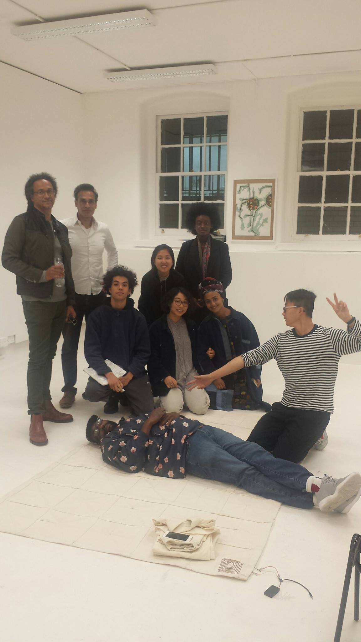 The group relaxing at the crit of the Beginnings of Truth exhibition with Dr Kimathi Donkor (far left).