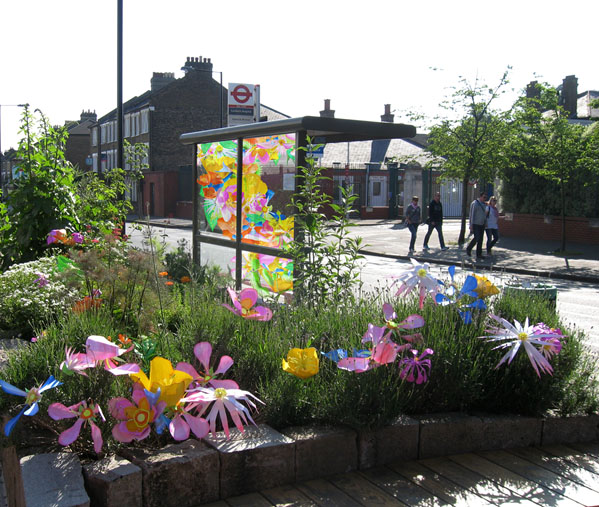 Community bus stop floral installation piece, with floral digital print design for the bus shelter by Hannah Miles