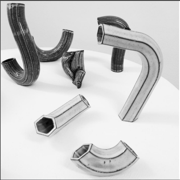 Tas' ceramic tubes on display in Raum Gallery