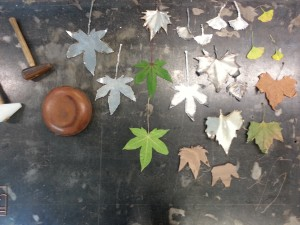 A Collation of real and artificial leaves Omer made including Steel, Aluminium and wood.