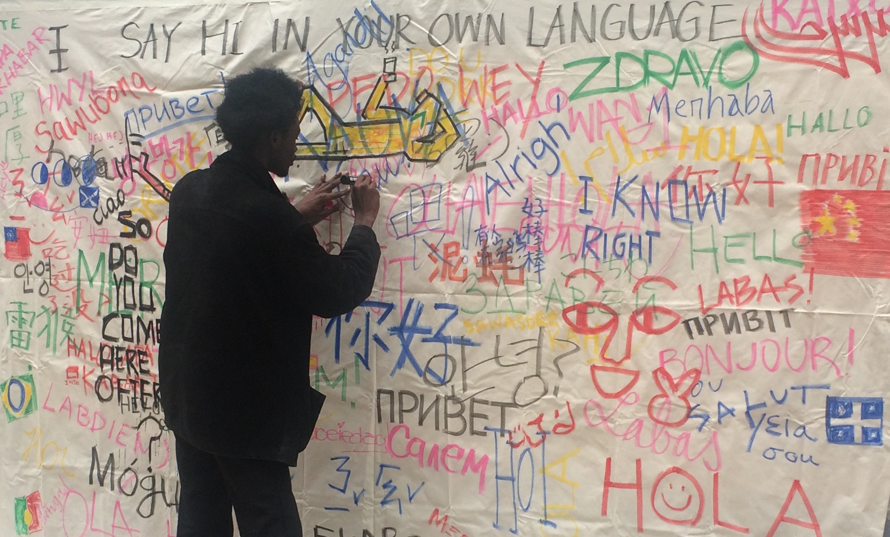 'Say hi in your own language', the Street, 26 October 2016