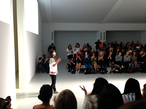 Jackie Lee takes a bow at the end of her Spring Summer 2014 catwalk show at Somerset House
