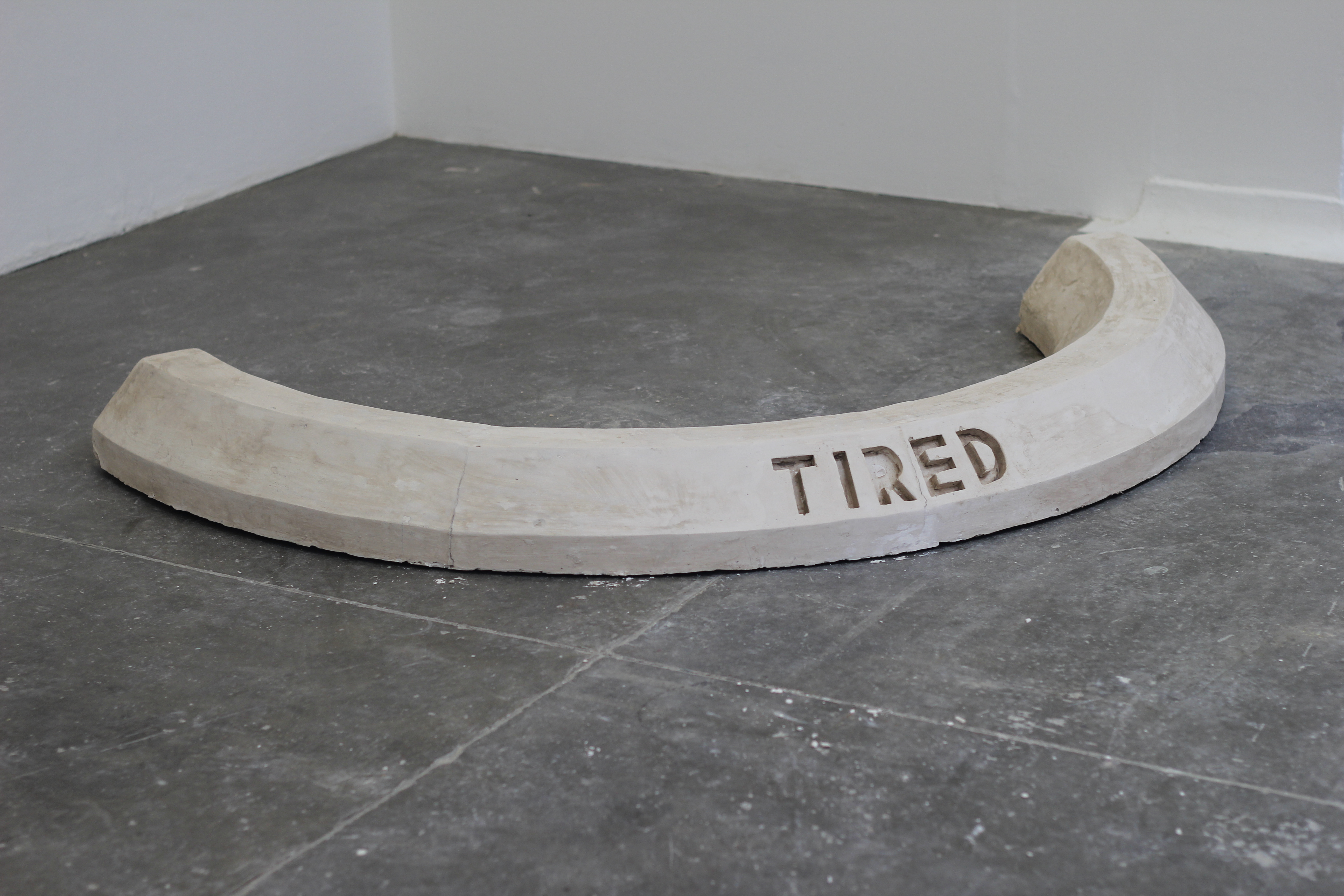 Parking kerb Sculpture 'Tired' by Josh Philpott