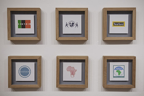 ogos of Non Profit Organisations working in Kenya (some of which are imaginary) : installation, silk screen, 80 x 230 x 5 cm each [6 of 24], 2010, ongoing, © Sam Hopkins
