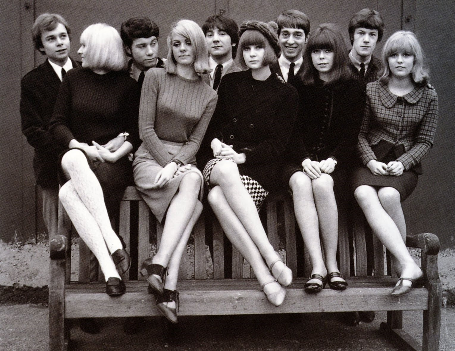 A black and white photo of a group of Mod boys and girls