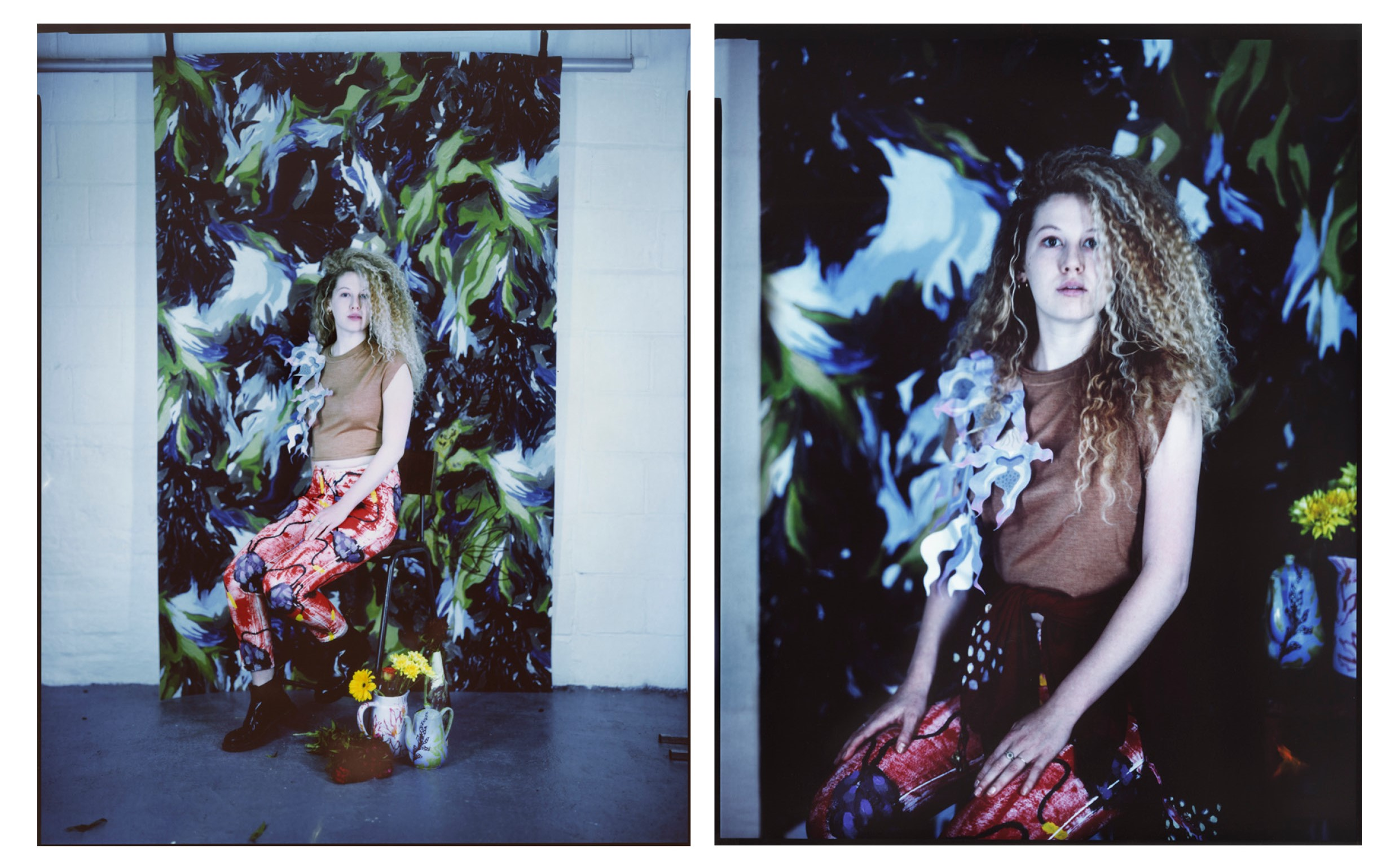 Model posed in front of printed fabric