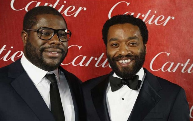 Steve McQueen (L) poses backstage at the Baftas with Chiwetel Ejiofor from 12 Years A Slave after winning Director of the Year at the 2014  Photo: Reuters
