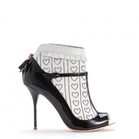 Sadie' by Sophia Webster. Black patent t bar with white calf laser cut sock detail.