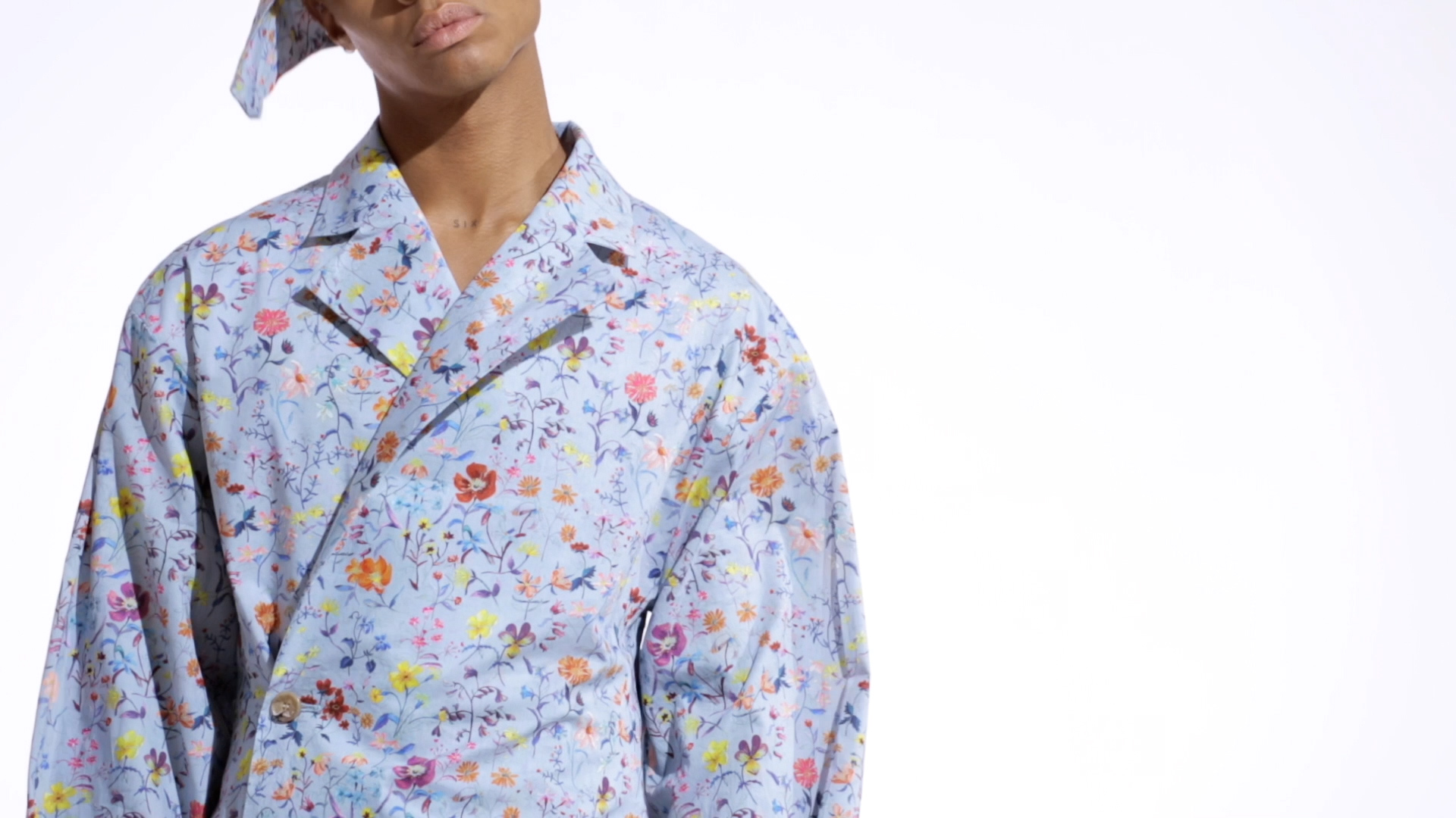 Sky blue two piece shirt with rainbow coloured floral accents