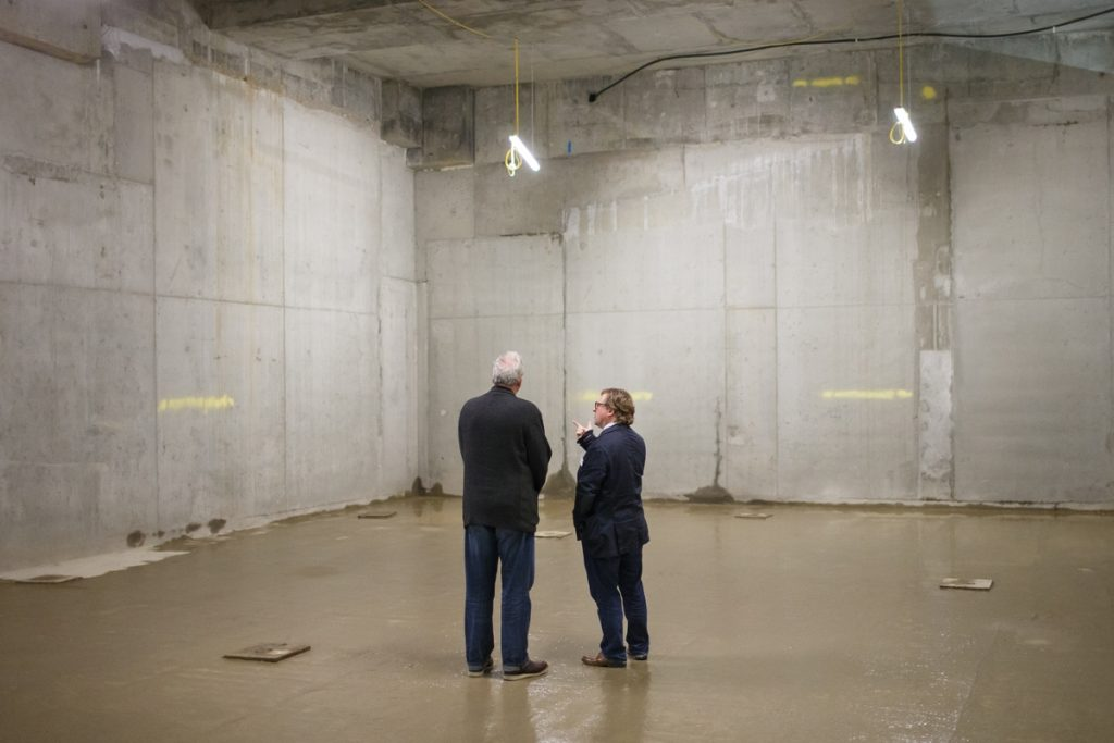 Pro Vice-Chancellor and Head of Camberwell, Chelsea and Wimbledon Chris Wainwright and Dean of Camberwell, Nick Gorse, admire the basement space that will house the new 262-seat lecture theatre for Camberwell.