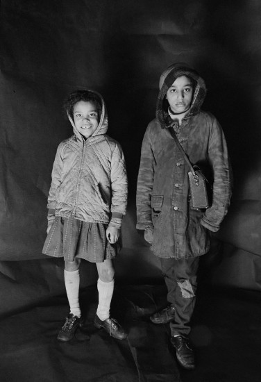 Portrait of Angela Loretta Lindsey, aged 8, with her brother Mark Emanuel Lindsey in Meadows's free photographic studio on Greame Street, Moss Side, Manchester, February - April 1972.