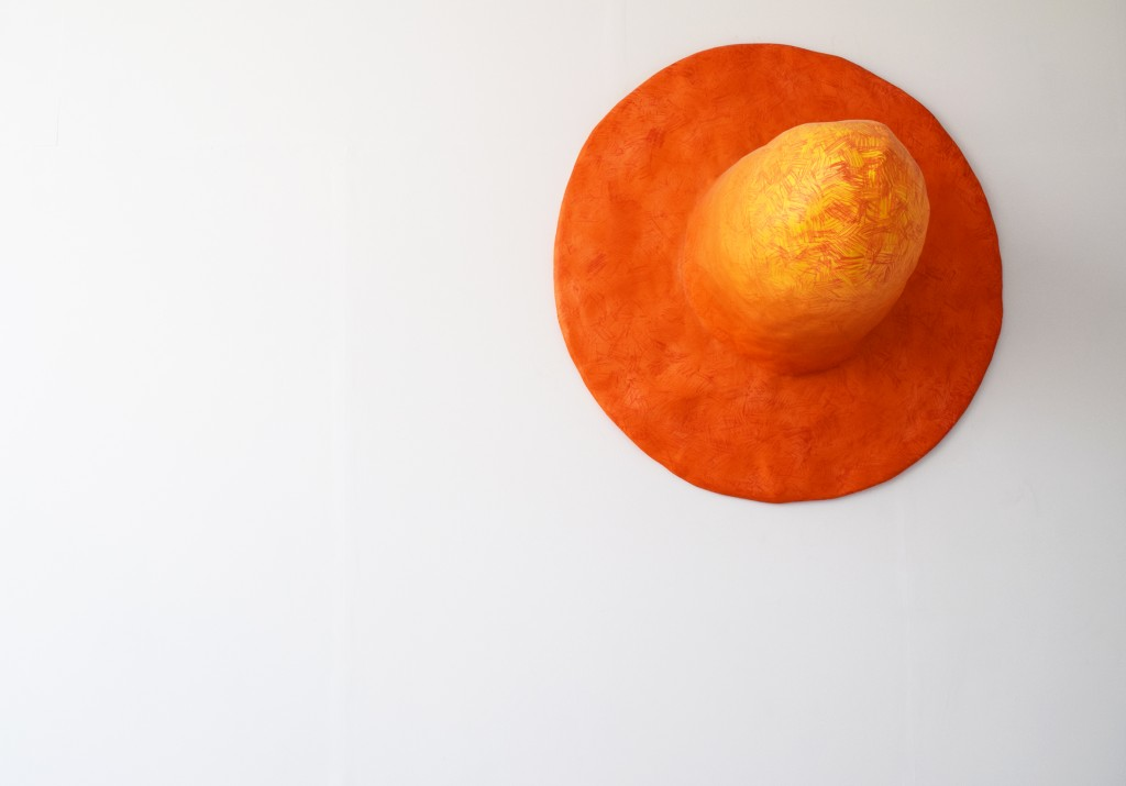Large scale cast orange Fedora hat hanging on wall Hamish Pearch (BA Sculpture 2015)