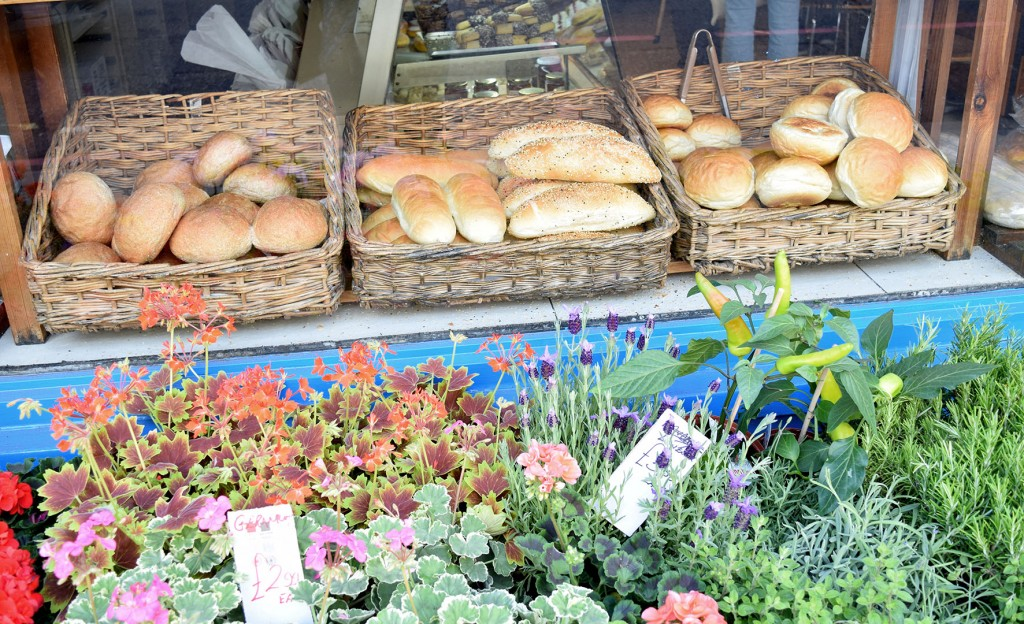 Photography of the Sophocles bakery rolls and flowers on display outside