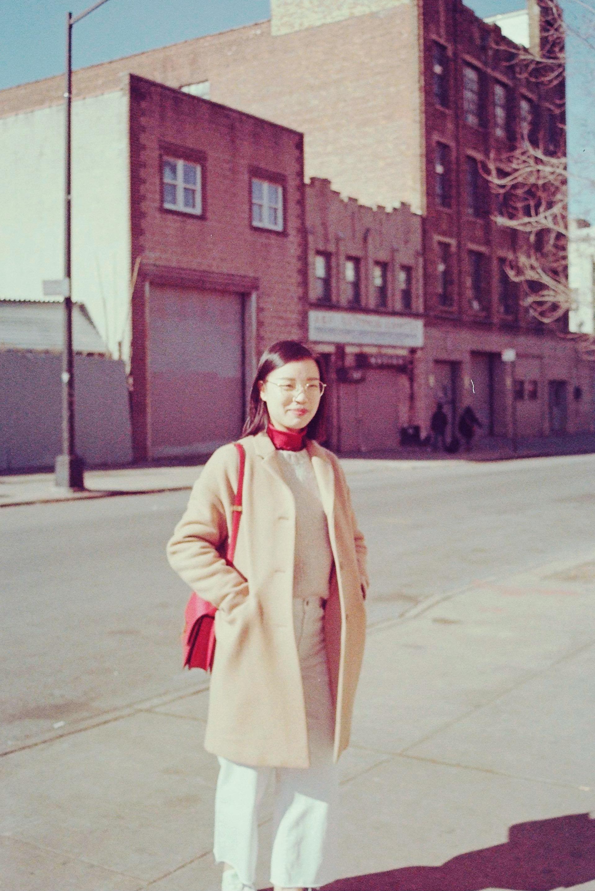 A portrait photo of Tina Li smiling to the camera