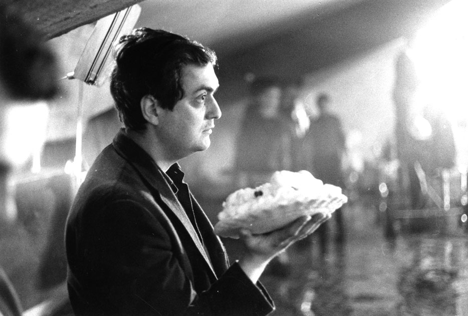Stanley Kubrick on set during the deleted 'Pie fight' scene, c1963.