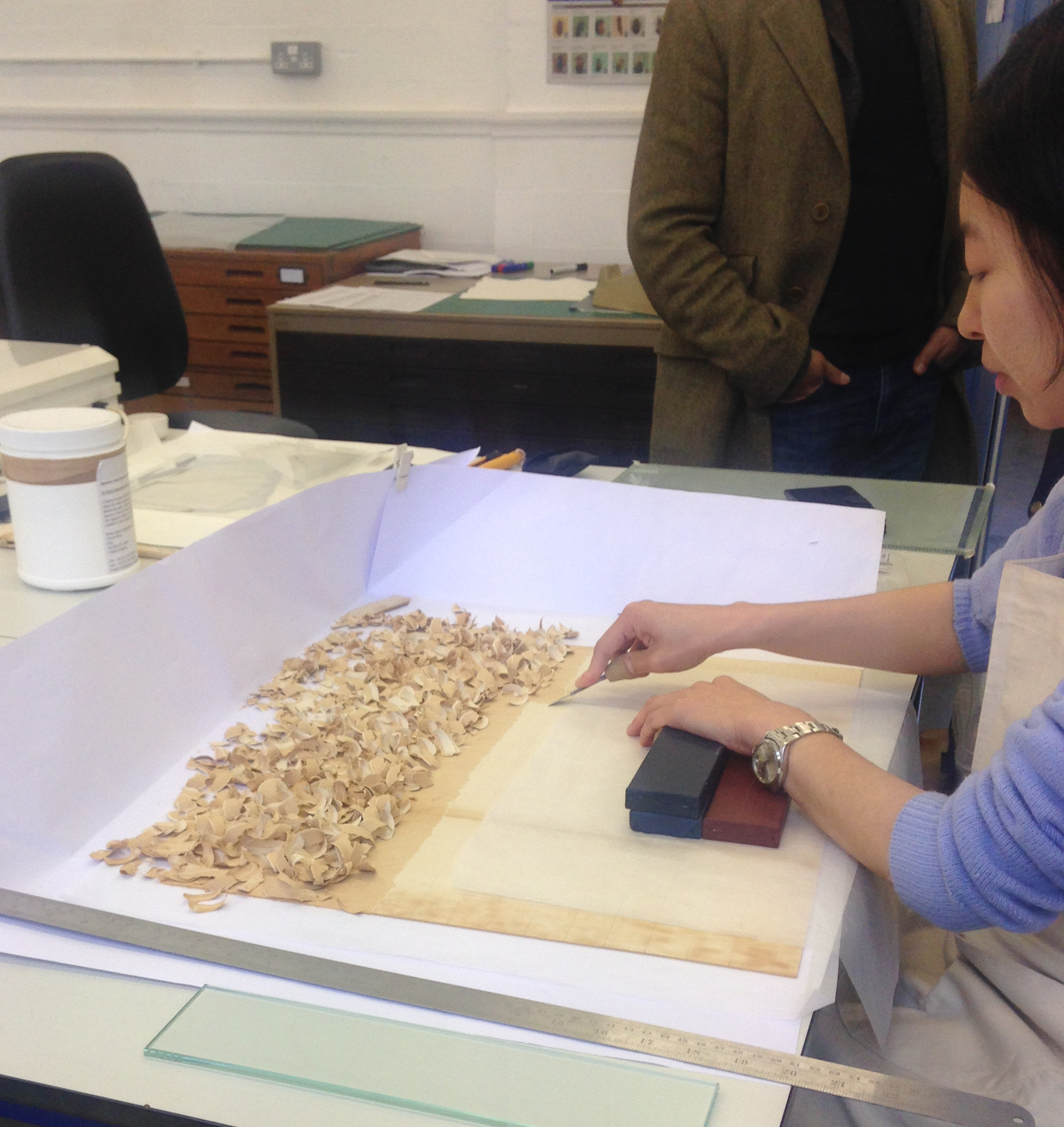 Student Cathy, removing the current backing from a Royal Botanical Garden, Kew piece