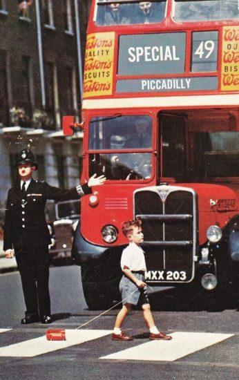 Boy walks with little bus
