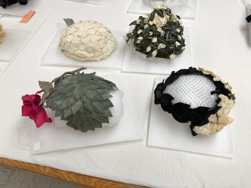 Group of rose adorned hats