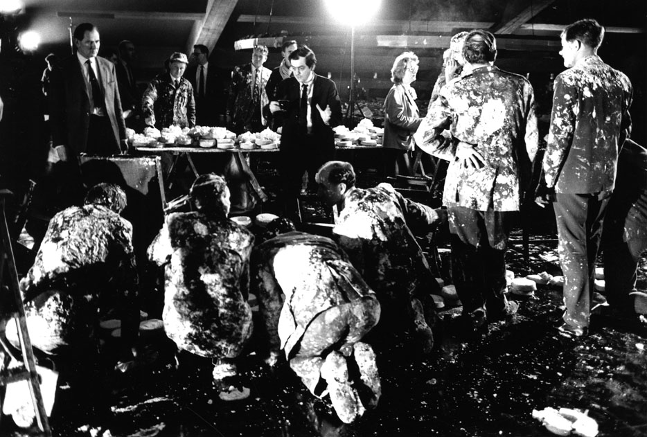Stanley Kubrick on set with cast members during the deleted 'Pie fight' scene, c1963