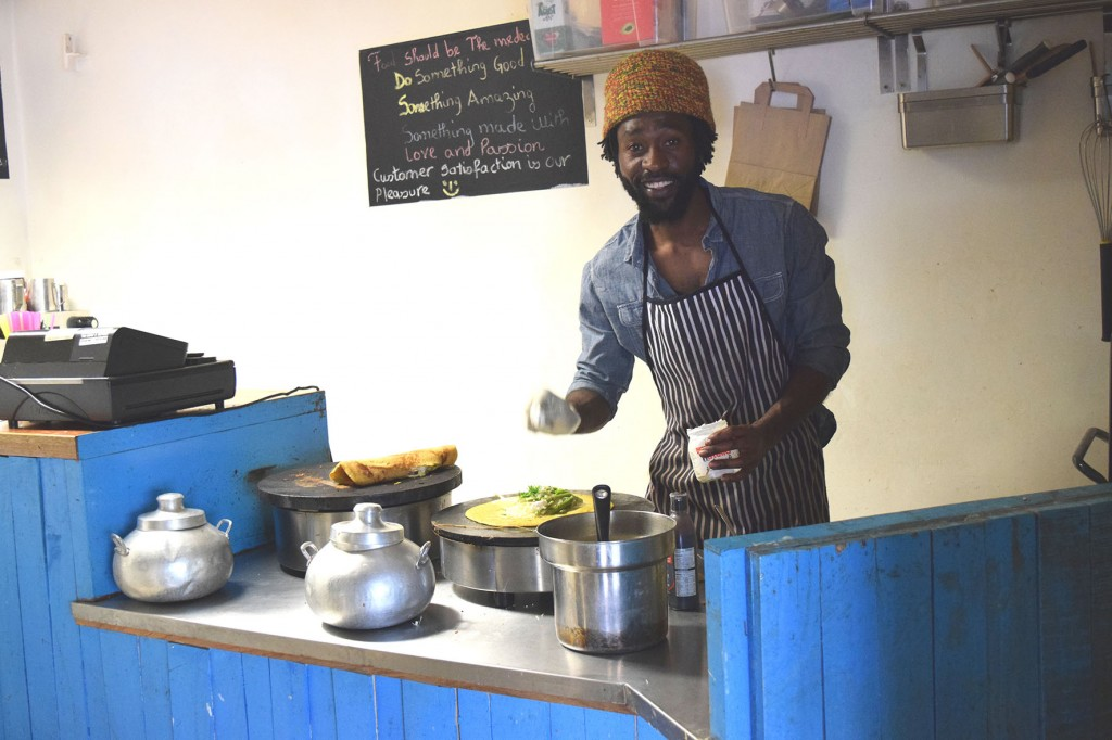 Photograph of one of the Maloko chefs making crepes in the kitchen