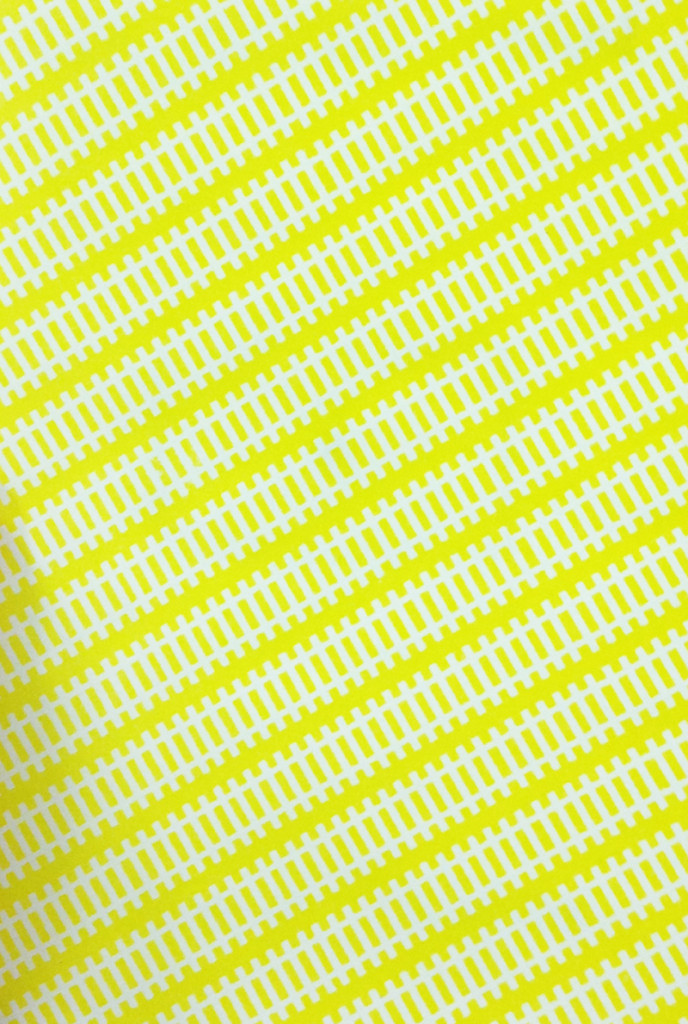 Book cover photo. Bright yellow and white geometrical pattern