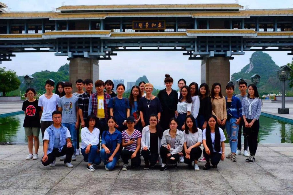 group of people with temple background