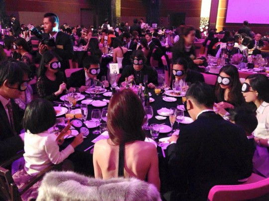 Alumni taking part in fundraising dinner