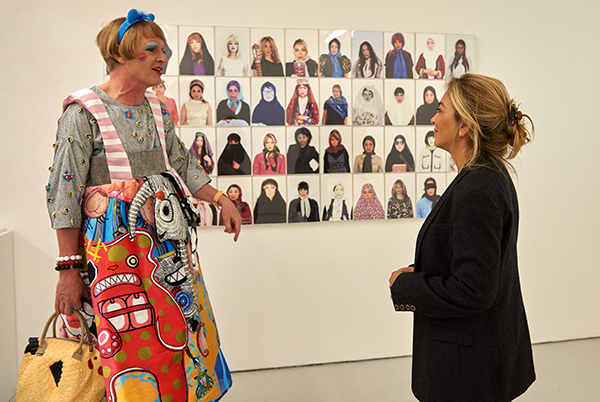 Grayson Perry UAL Chancellor chats to Chelsea College of Arts graduate Shadi Mahsa at the UAL summer shows