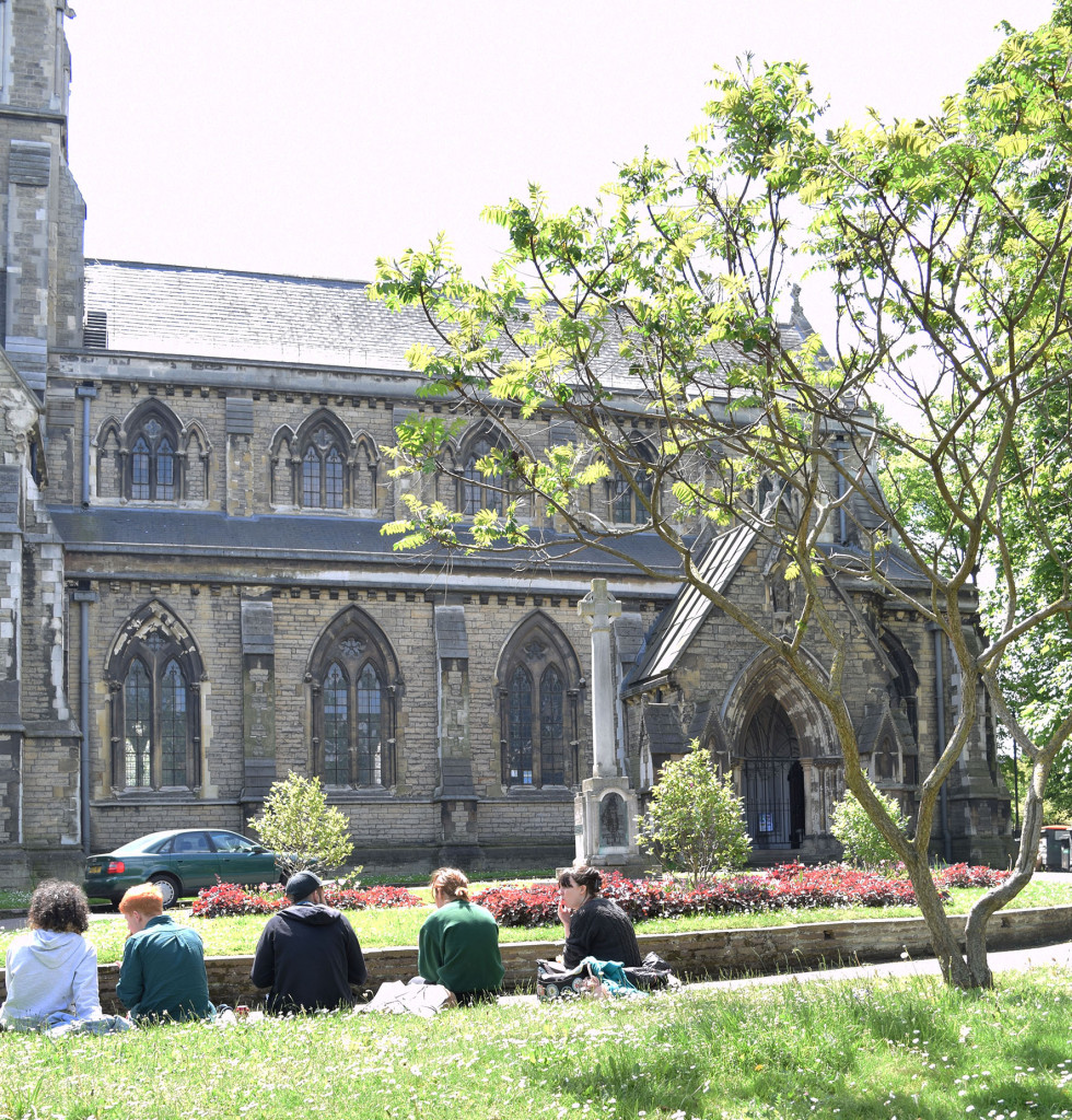 Photograph of students relaxing outside St Giles Church