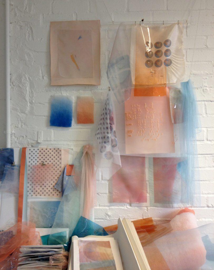 Studio in progress - hanging fabrics, and dye samples.