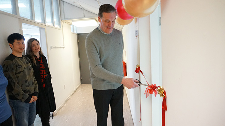 Dean of the Fashion Business School, Andrew Hughes, cutting the red ribbon