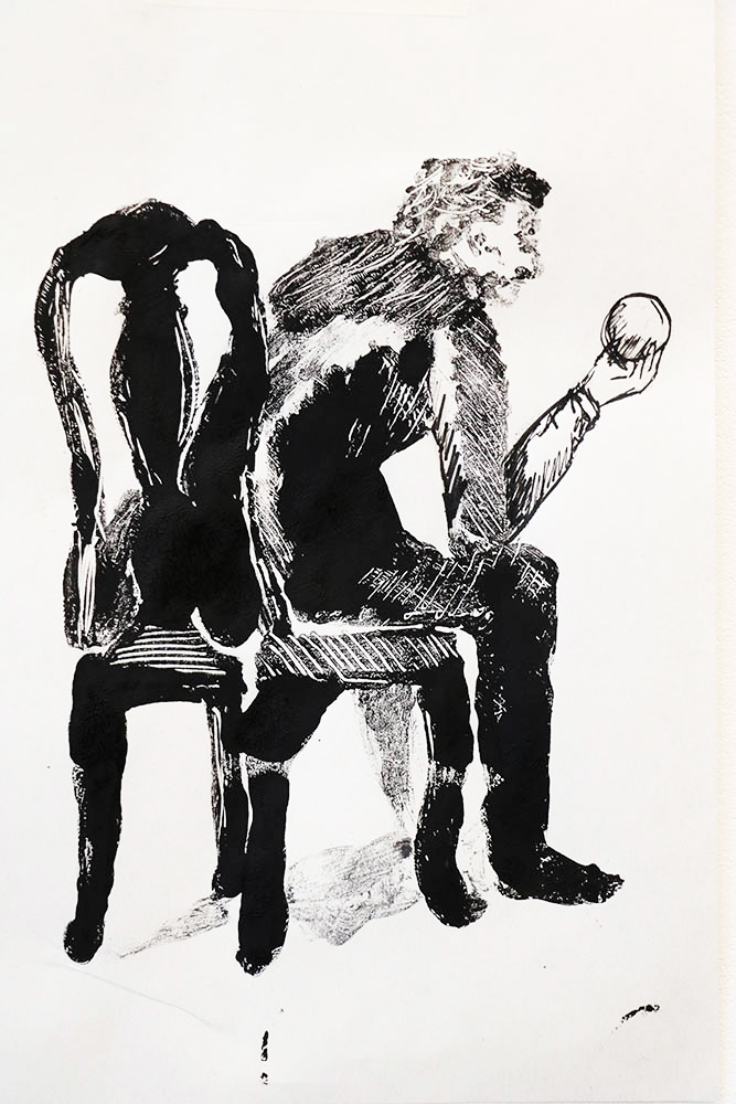 Black paint on white paper lino print of a man sat in a chair holding a ball, by Valentina Schuchner.