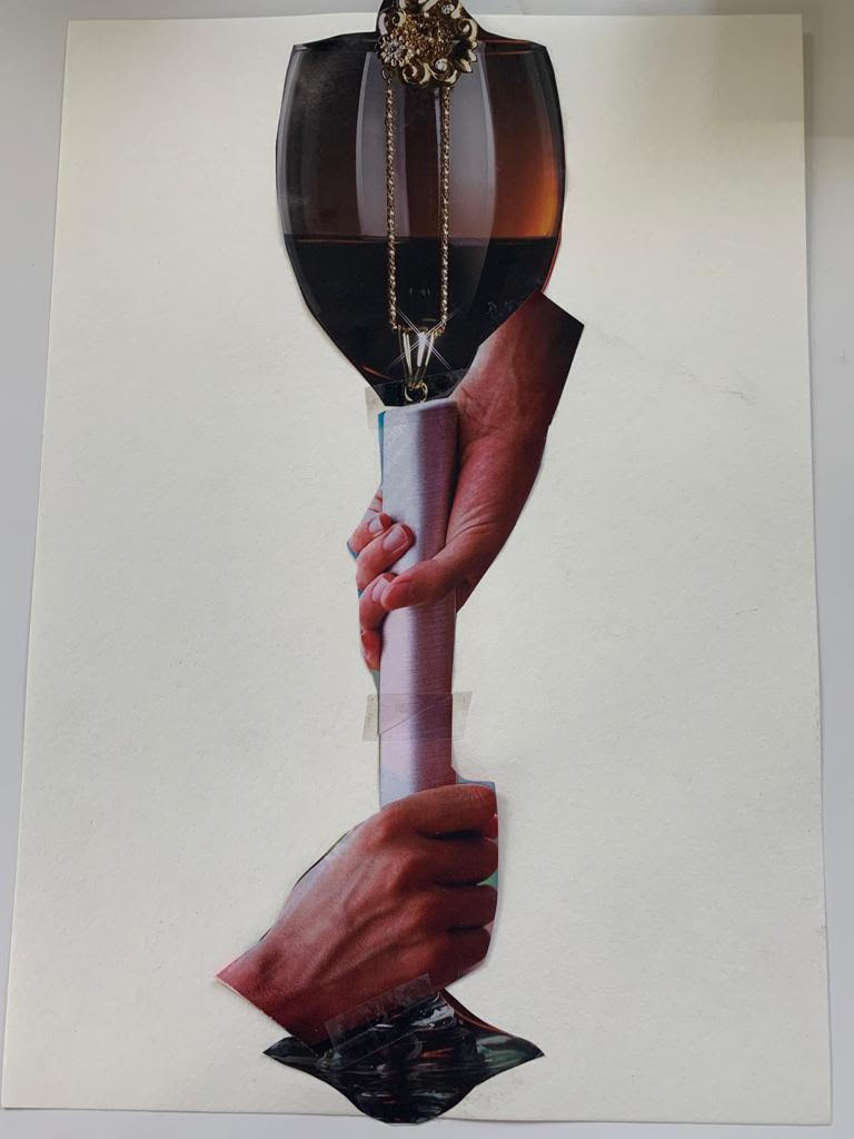 Cut up magazine images put together to look like a tall glass of wine. Two hands are clasped grabbing the base of the wine glass from either side.