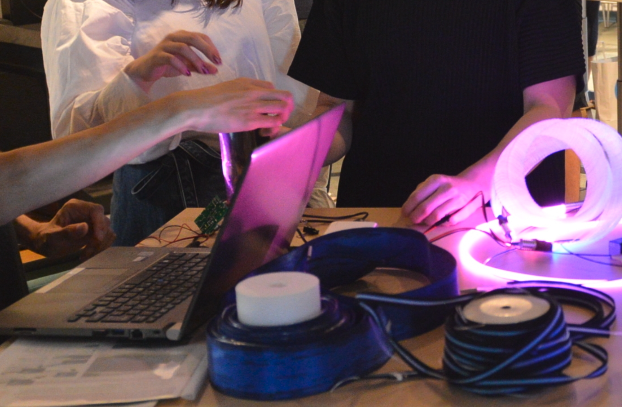 People working together with computer and materials