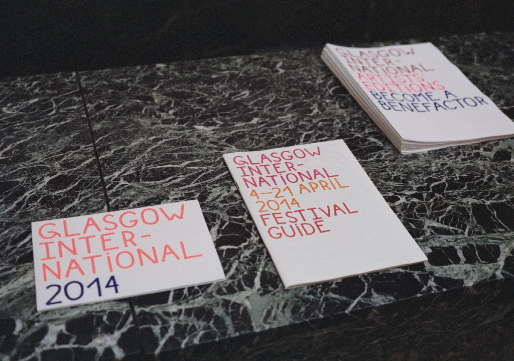Guides to Glasgow International, three guides printed in Red and Blue on top of a marble surface