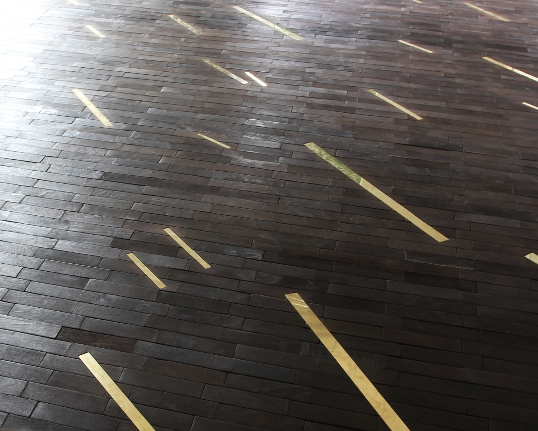 Charred parquet floor inlaid with brass that will feature at Chris' booth