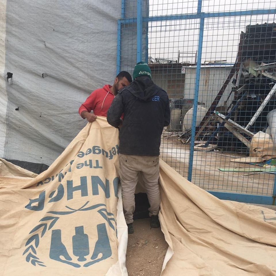 UN tent being torn in 2 by men