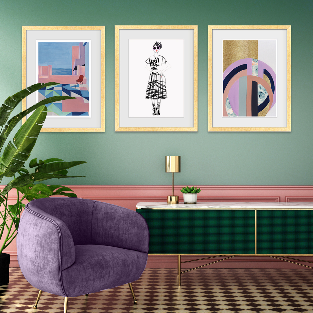 A photo of a green wall with framed pictures and a seat