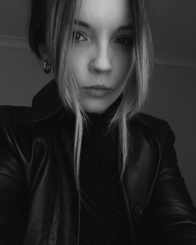 A black and white photo of Natalie Kate Lloyd