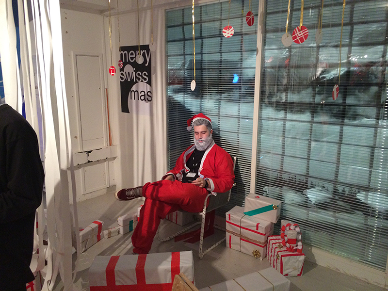 Santa surrounded by presents at BA Graphic Design Swissmass Christmas Party 2014