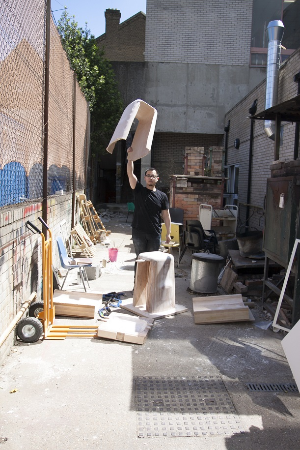 Mu Hau Kao creating his plywood stools outside the Camberwell workshops
