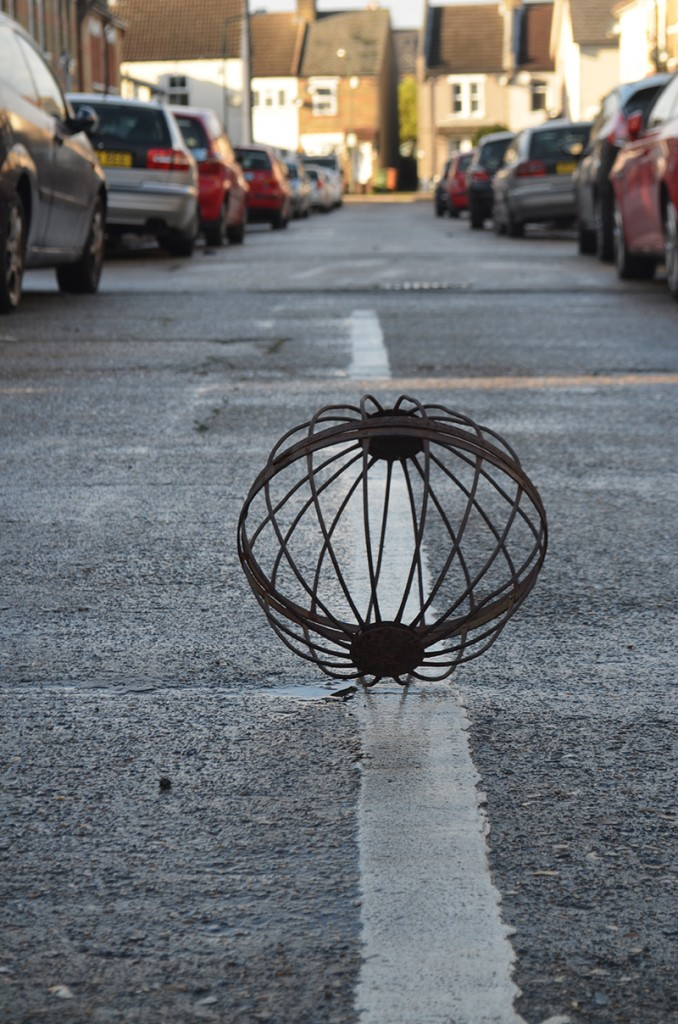 Photography - Briony Mitchell, sculpted wire sphere in road