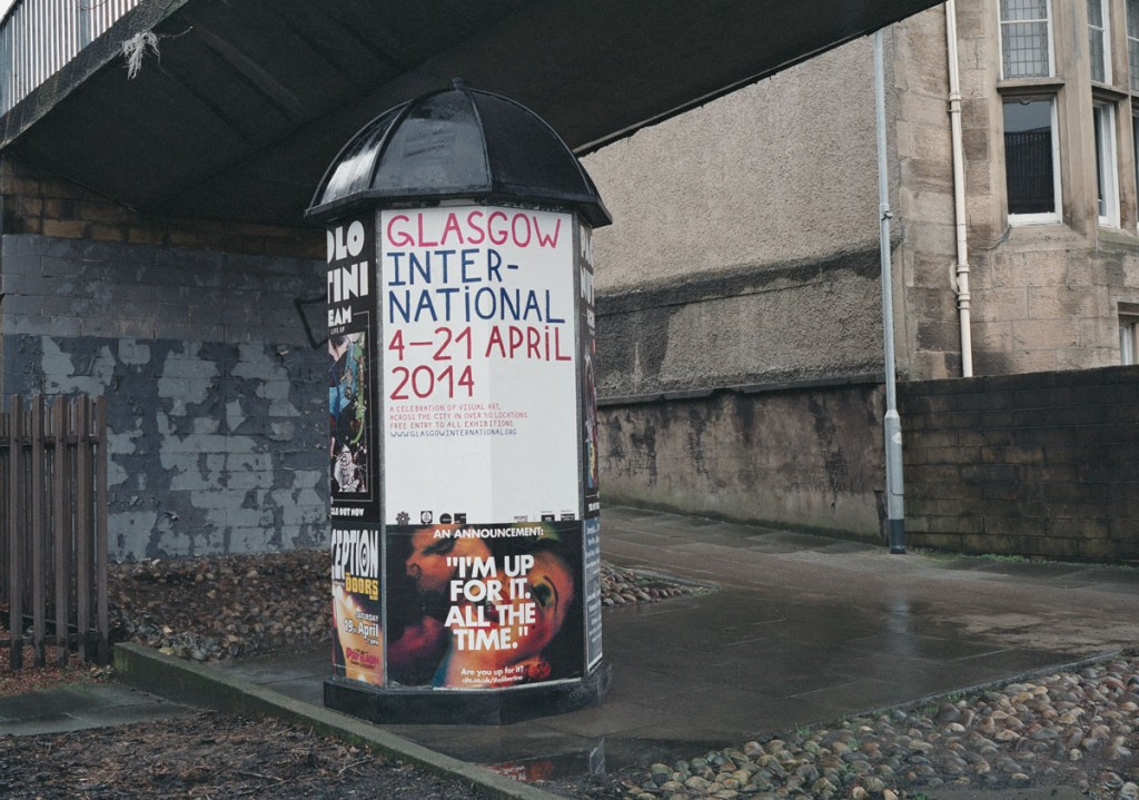 Big poster promoting Glasgow International festival printed on white paper with red and blue ink