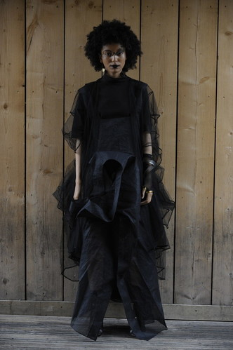 A photo of a model wearing goth-style clothing on the runway by Haoxin Cheng and Waiyan Choi