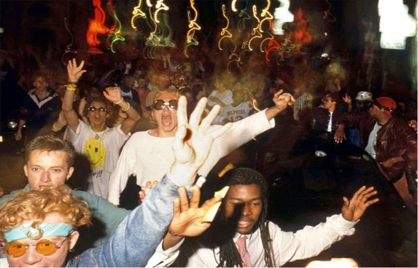 A photo taken in a London night club with young ravers