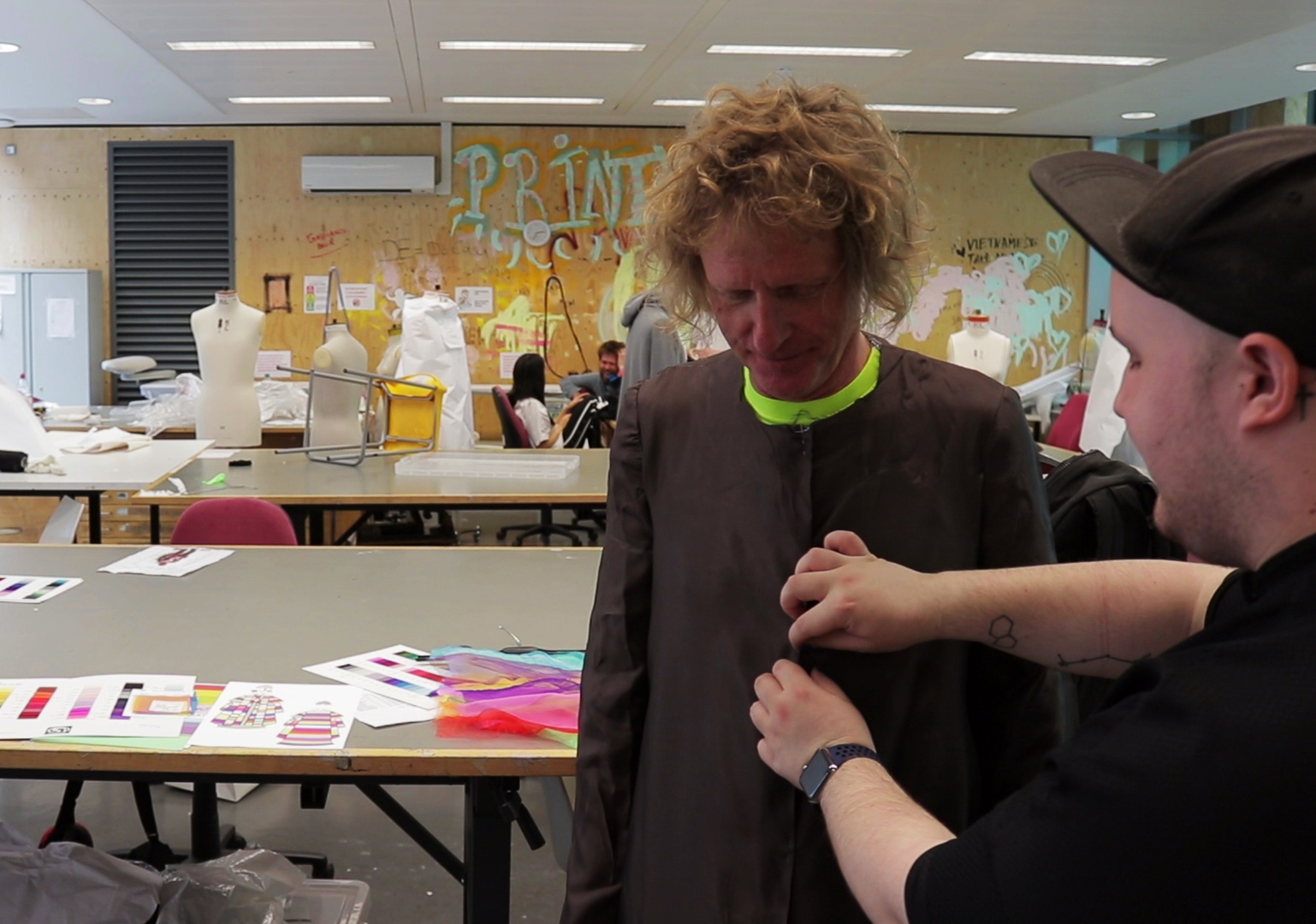 Winning student Keith Tovey at one of the fitting sessions with Grayson at Central Saint Martins, UAL