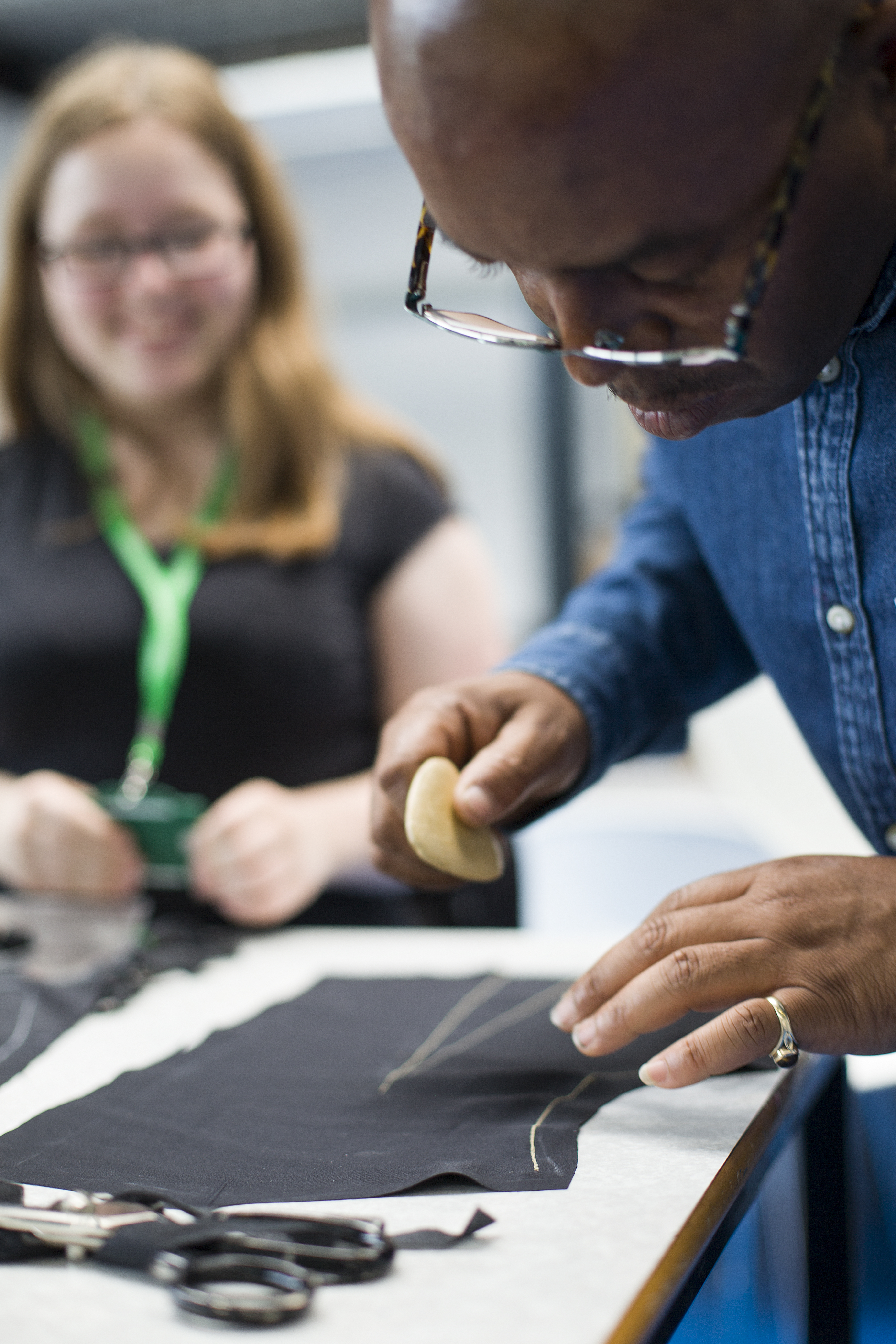 Winston Rose teaching the college students tailoring skills