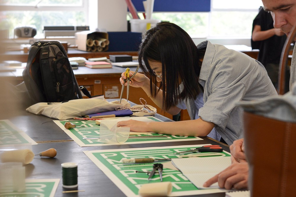 Students working on their photobook during their bookmaking session at LCC studios. Image by Bryan Lanas.